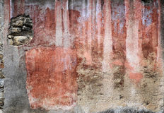 Shades of red on a multicolored stucco wall Stock Photos