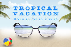 Shades of a Tropical Vacation. Conceptual of a vision of a tropical vacation through sunglasses Royalty Free Stock Photo