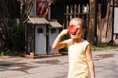 Boy shading sun with leaf Stock Photo