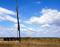 Shadoof in the meadow. Shadoof for extraction water from wells Stock Photography