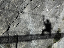 Shadow. Of a climber on a rock-wall royalty free stock photography