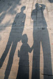 Shadow. Long Family of three shadow in urban background Stock Photography