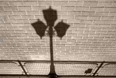 Shadow. Shade from a lantern on sidewalk Royalty Free Stock Photography