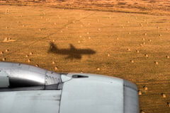 Shadow of the airplane and jet engine. Shadow of the airplane in a wheat field and a jet engine Stock Image