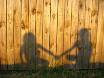 Shadow of the amicable boy and the girl. Image of shadow of the amicable boy and the girl royalty free stock photos