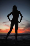 Shadow of attractive woman posing on the beach Royalty Free Stock Photography
