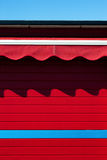 The shadow of the awnings on the red wall Stock Photography