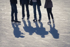 Shadow background of group of teenagers on the ice Stock Images