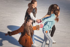 Shadow background of group of teenagers on the ice Royalty Free Stock Images