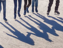 Shadow background of group of teenagers on the ice Stock Photography