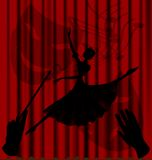Shadow ballet. Against the background of red theater curtain is an abstract shadow ballerina, the hands of a conductor and comedy-tragedy masks Stock Photos