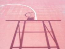 Shadow of basketball hoop stand Stock Photos