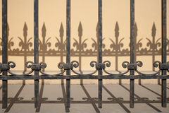 Shadow behind the ornate gate Stock Images