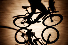 Shadow of the bicycle and cyclist Royalty Free Stock Photography