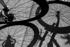 Shadow of bicycle. On grunge backgroung Royalty Free Stock Image