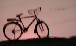 Shadow of Bicycle. Pink shadow of bicycle on sunset Royalty Free Stock Photos