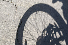 The shadow of bicycle wheel Stock Photos