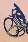 Shadow of the bike and biker Royalty Free Stock Photos