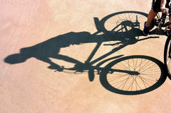 The shadow of the bike on a pink surface Royalty Free Stock Photography