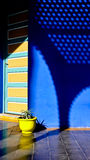 Shadow,blue and yeloow II. Nice contrast of colors in a typical home in Asilah, Morocco Royalty Free Stock Photo