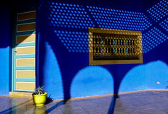 Shadow,blue and yeloow. Nice contrast of colors in a typical home in Asilah, Morocco Stock Images