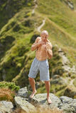 Shadow boxing on mountain Stock Photo