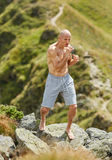 Shadow boxing on mountain Royalty Free Stock Images