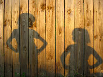 Shadow of boy and girl staring each other Stock Images