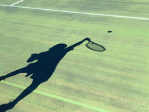 Shadow of a boy playing tennis Royalty Free Stock Photo