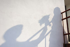 The shadow of the bride and groom on wall Royalty Free Stock Photo