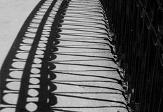 The shadow of the bridge railing Royalty Free Stock Images