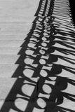 The shadow of the bridge railing Stock Photography
