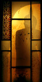 Shadow of the Buddha in the window Royalty Free Stock Images