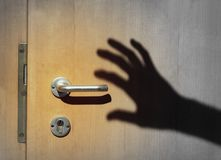 Shadow of a burglar breaking into a house royalty free stock images