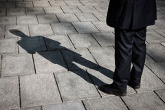 Shadow of a businessman standing Royalty Free Stock Images