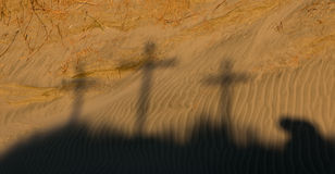 Shadow of Calvary. Soft shadow of Calvary, three cross and a man praying beside them Royalty Free Stock Photo