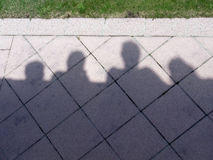 Shadow caricature of people. In the sun royalty free stock image