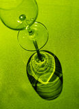 Shadow cast by wine glass on g Stock Photography