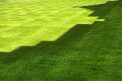 Shadow of castle on grass. Shadow of castle battlements on green lawn or grass Stock Photos