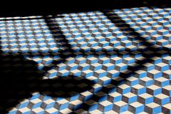 Shadow on a checkered floor. A picture shadow on a checkered floor in Paris France Royalty Free Stock Image