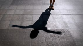 Shadow of A Child Standing on the Tiled Floor and Spreading His Arms. Shadow of A Child Standing on the Tiled Floor and Outstretching His Arms Royalty Free Stock Image