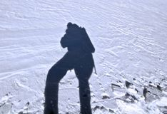 Shadow of climber at the snow surfase, Caucasus Royalty Free Stock Photos