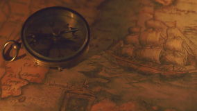 The shadow of the compass showing on the map stock video footage