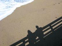 Shadow of couple on beach Royalty Free Stock Photos