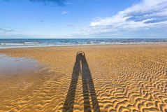 Shadow of couple on beach Royalty Free Stock Photo