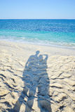 Shadow of couple on the beach Royalty Free Stock Images