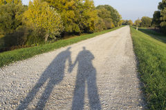 Shadow of a Couple on the Dirt Road Stock Photos