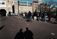 Shadow of a couple in front of the national museum of Netherlands Amsterdam royalty free stock image