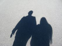 Shadow of couple. A shadow of a couple holding hands stock images
