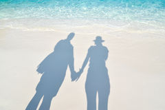 Shadow of couple holding hands. On the beach royalty free stock image